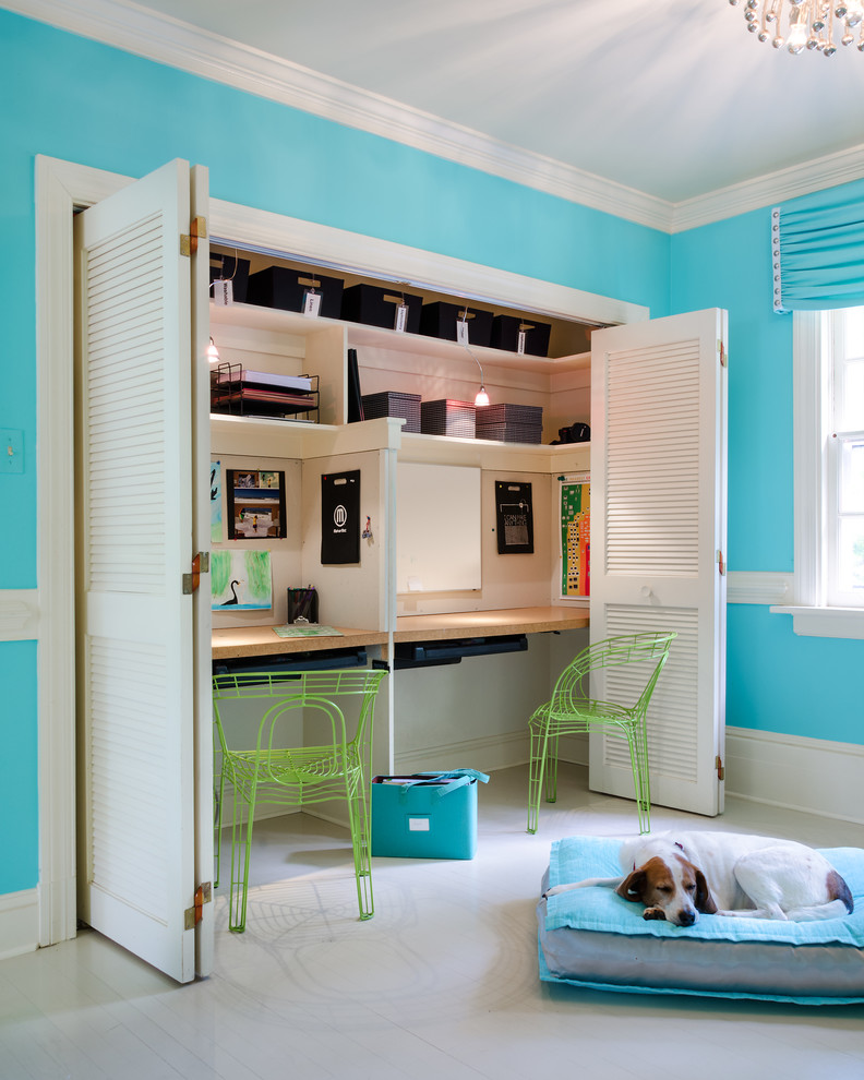 Example of a trendy kids' room design in Richmond with blue walls