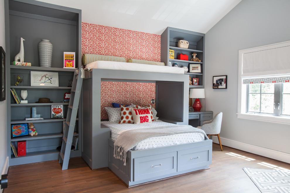 Kids' bedroom - transitional medium tone wood floor kids' bedroom idea in Houston with gray walls