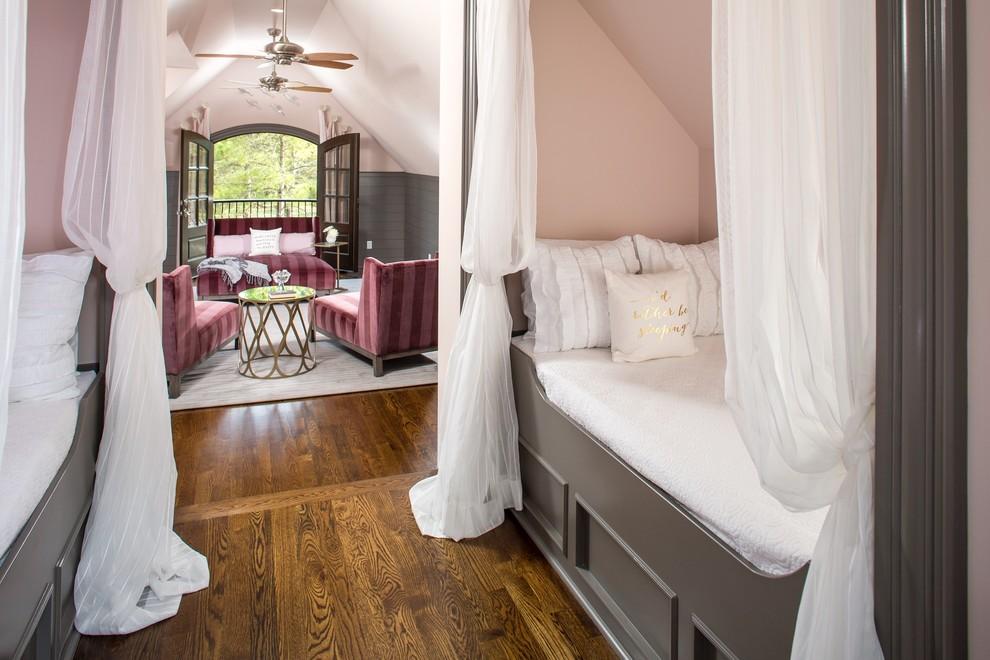 Elegant girl medium tone wood floor kids' bedroom photo in Raleigh with pink walls