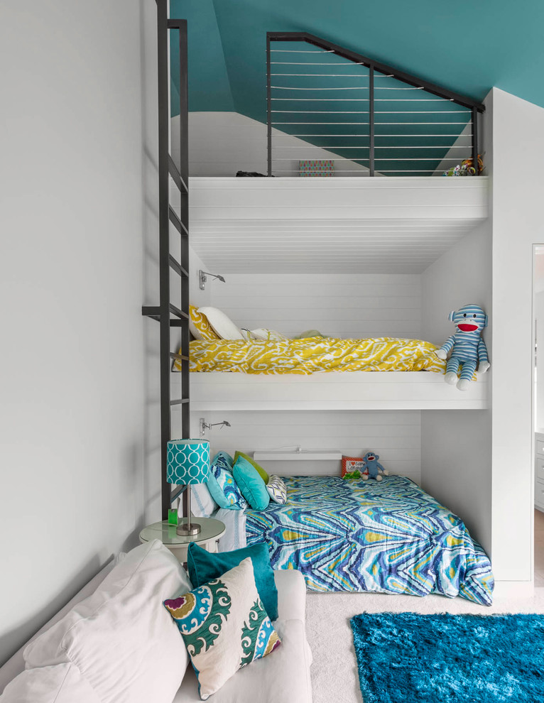Example of a trendy boy kids' room design in Dallas with white walls