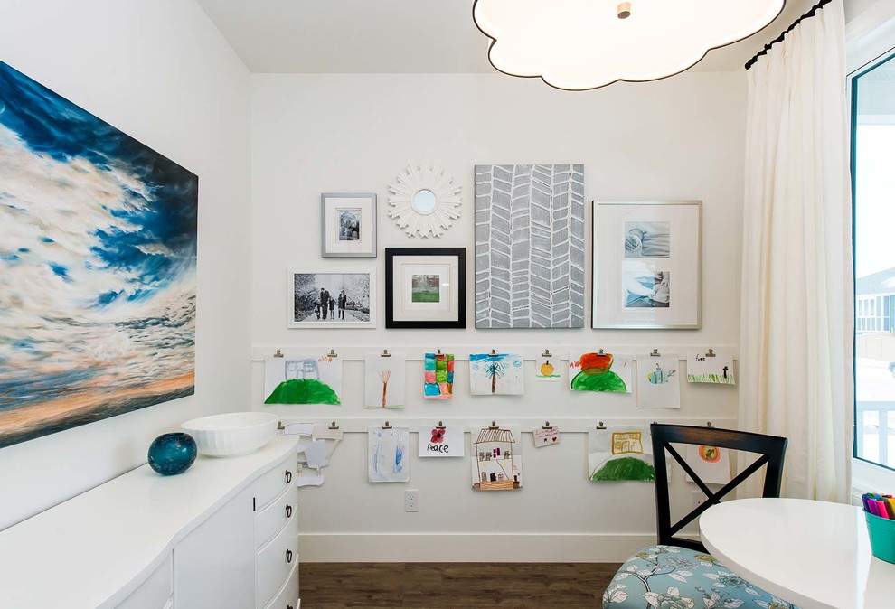 Inspiration for a transitional gender-neutral dark wood floor kids' room remodel in Other with white walls