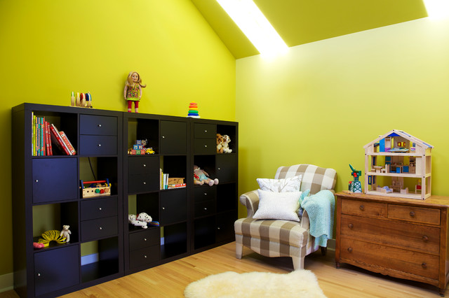 Design ideas for a medium sized classic gender neutral children's room in Calgary with yellow walls, light hardwood flooring and beige floors.