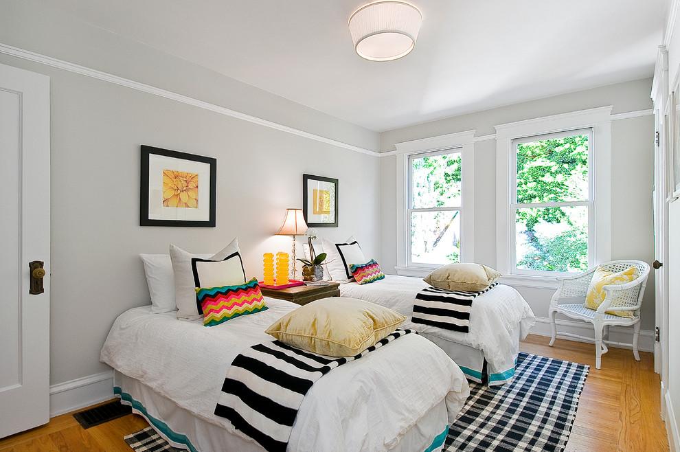 Eclectic girl medium tone wood floor and beige floor kids' room photo in San Francisco with gray walls
