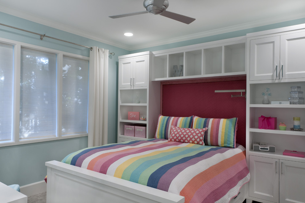 Example of a classic girl kids' room design in Sacramento with blue walls