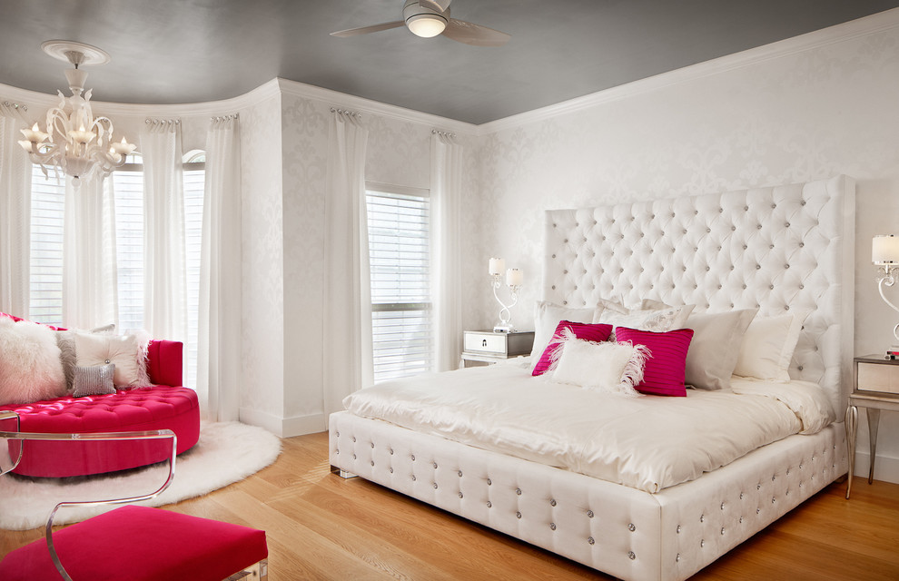 Kids' room - large contemporary girl medium tone wood floor kids' room idea in Austin with white walls