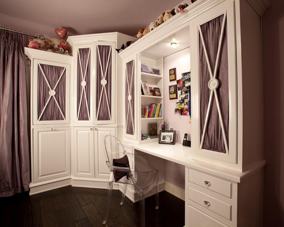 Example of a classic girl dark wood floor kids' room design in Las Vegas with beige walls
