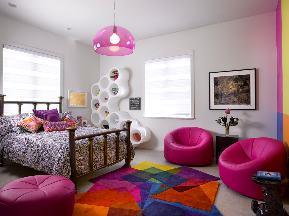 Example of a trendy girl carpeted kids' room design in Miami with white walls