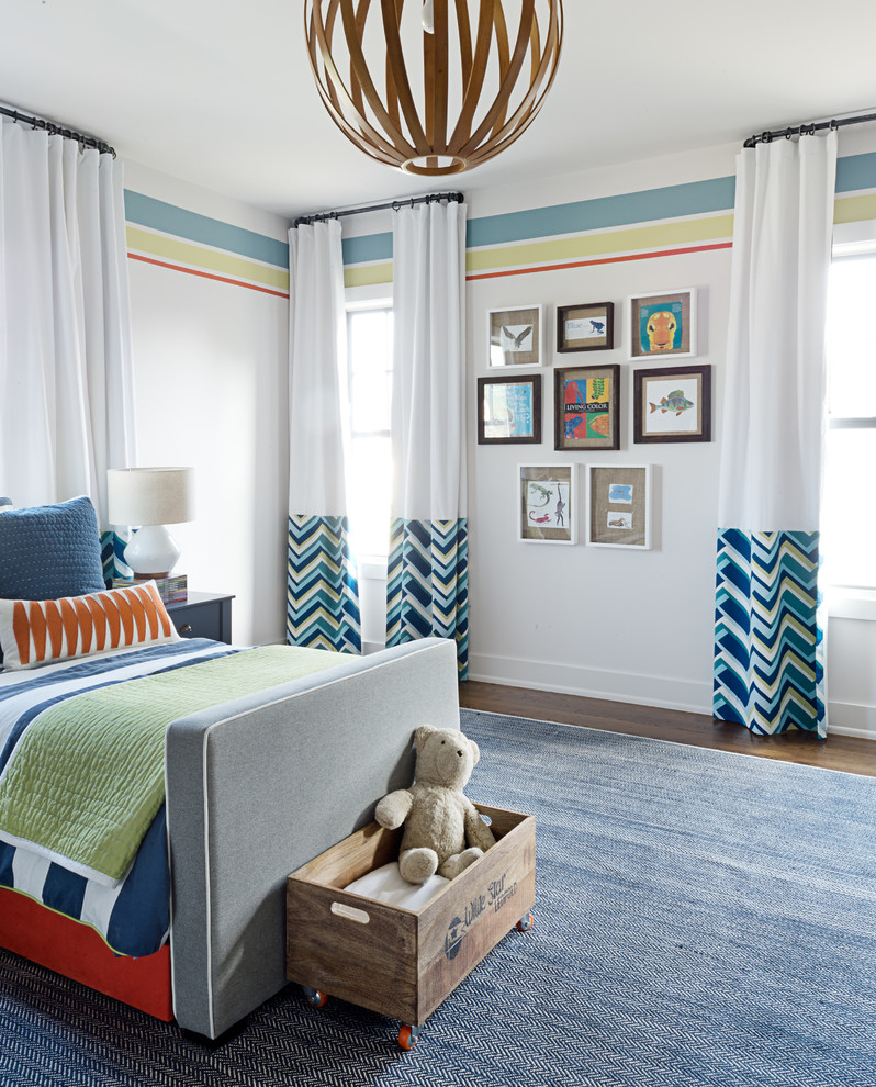 Inspiration for a mid-sized transitional gender-neutral medium tone wood floor and brown floor kids' room remodel in Other with multicolored walls