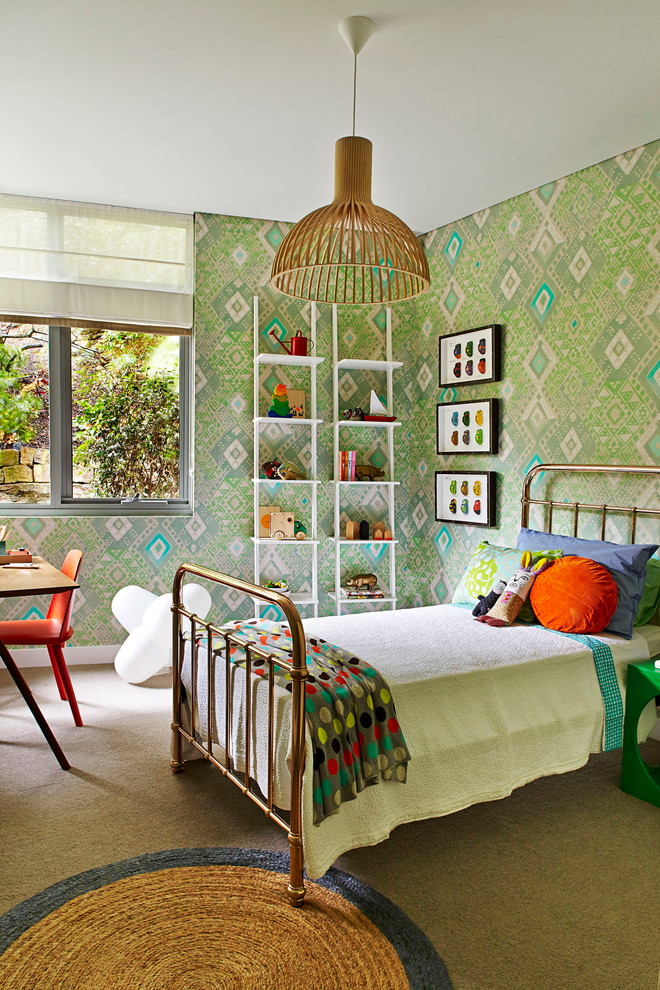 Inspiration for a mid-sized contemporary girl carpeted kids' room remodel in Sydney with green walls
