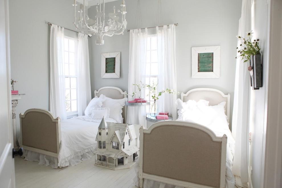 Inspiration for a small country girl painted wood floor kids' room remodel in Austin with gray walls