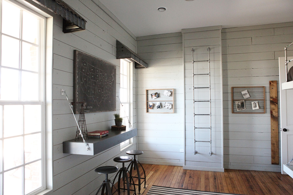 Kids' room - mid-sized farmhouse boy medium tone wood floor kids' room idea in Austin with white walls