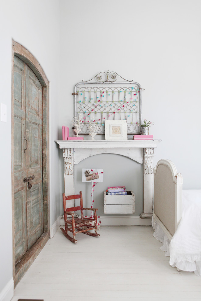 Inspiration for a small farmhouse girl painted wood floor kids' room remodel in Austin with gray walls