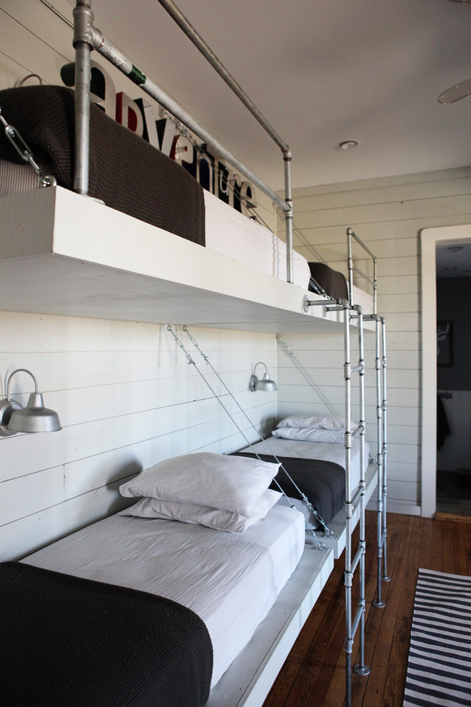 Inspiration for a mid-sized country boy medium tone wood floor kids' room remodel in Austin with white walls