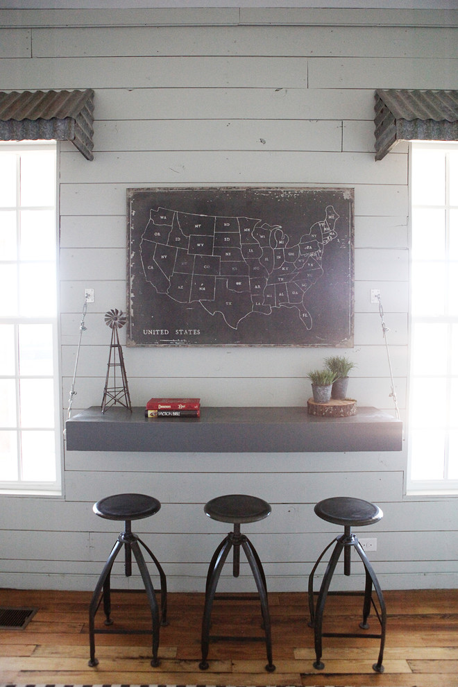 Example of a mid-sized cottage boy medium tone wood floor kids' room design in Austin with white walls