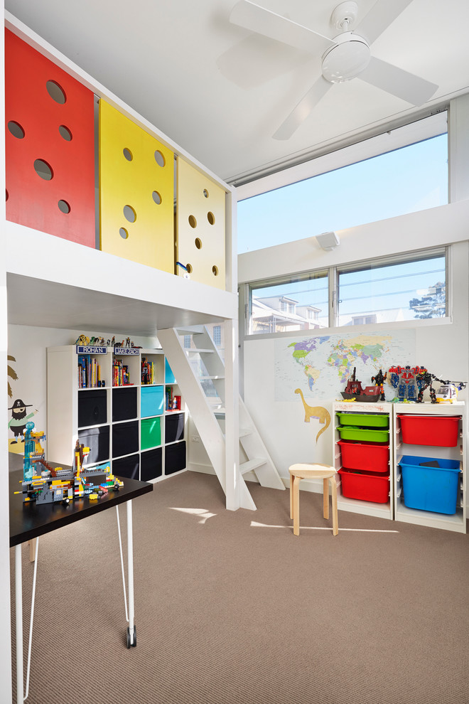 Example of a trendy gender-neutral carpeted playroom design in Sydney with white walls