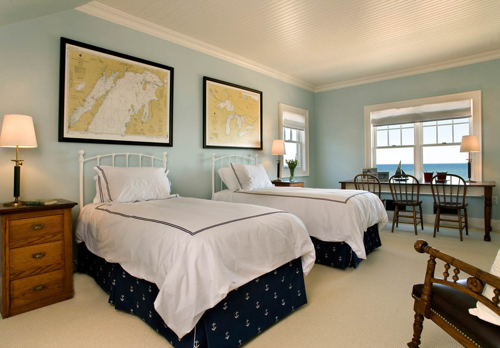 Example of a mid-sized beach style gender-neutral carpeted and beige floor kids' room design in Milwaukee with blue walls