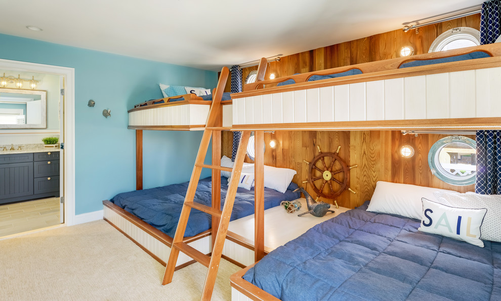 Example of a beach style gender-neutral kids' room design in Other with blue walls