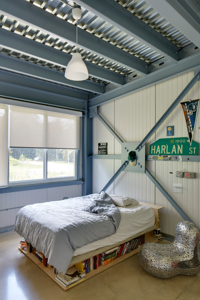 Inspiration for an industrial boy concrete floor kids' bedroom remodel in Miami with white walls