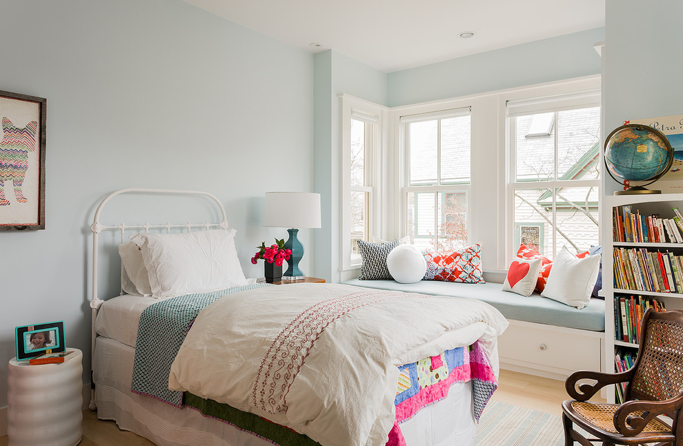 Inspiration for a mid-sized scandinavian girl light wood floor kids' bedroom remodel in Boston with blue walls