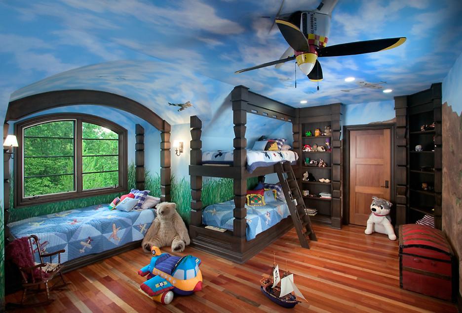 Huge elegant boy light wood floor kids' room photo in Grand Rapids with blue walls
