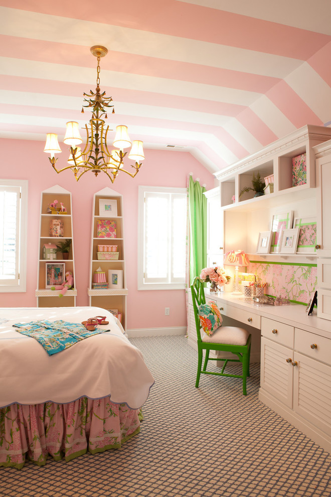 Elegant kids' room photo in Other with pink walls