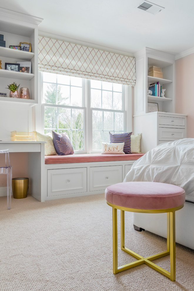 Mid-sized transitional girl carpeted and beige floor kids' room photo in Boston with pink walls