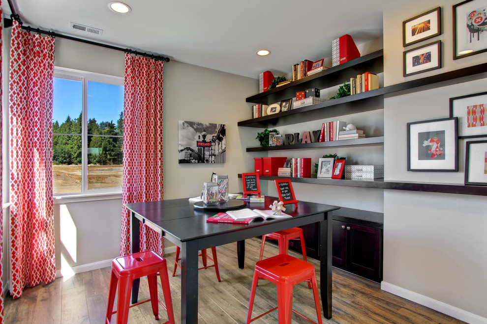 Inspiration for a transitional gender-neutral medium tone wood floor kids' room remodel in Seattle with gray walls