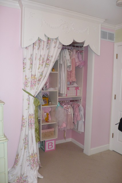 Unique childs' closet utilizing wood valance and fabric curtain instead of doors transitional-closet
