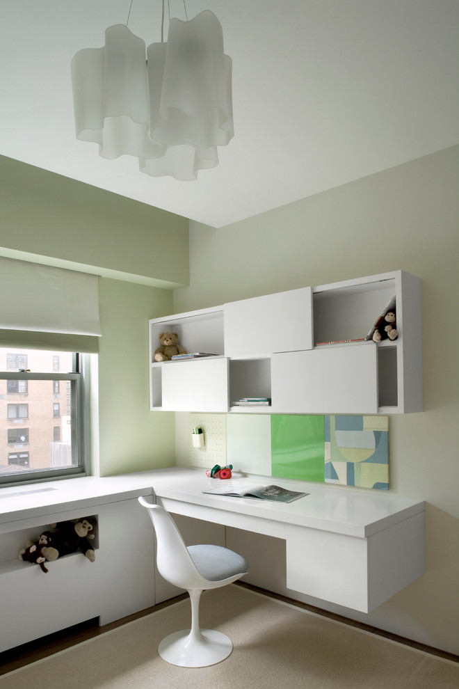 Inspiration for a modern kids' room remodel in New York with green walls