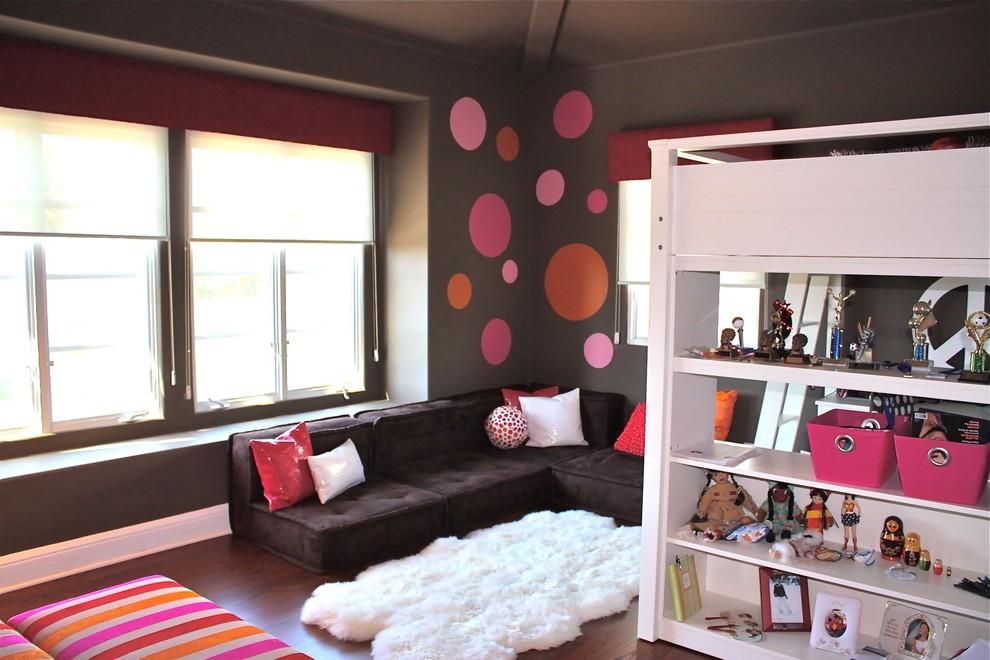 Trendy medium tone wood floor and brown floor teen room photo in Orange County with multicolored walls