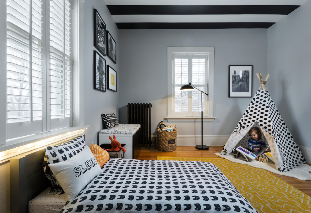 Small trendy boy light wood floor kids' room photo in Chicago with gray walls