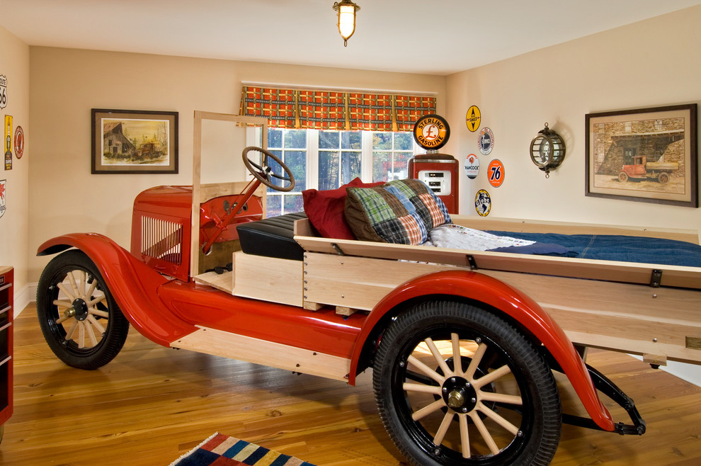 Inspiration for an eclectic boy medium tone wood floor kids' bedroom remodel in New York with beige walls