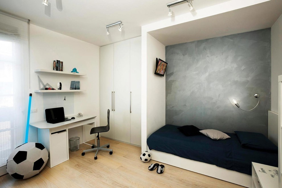 Mid-sized danish boy light wood floor kids' room photo in Florence with gray walls