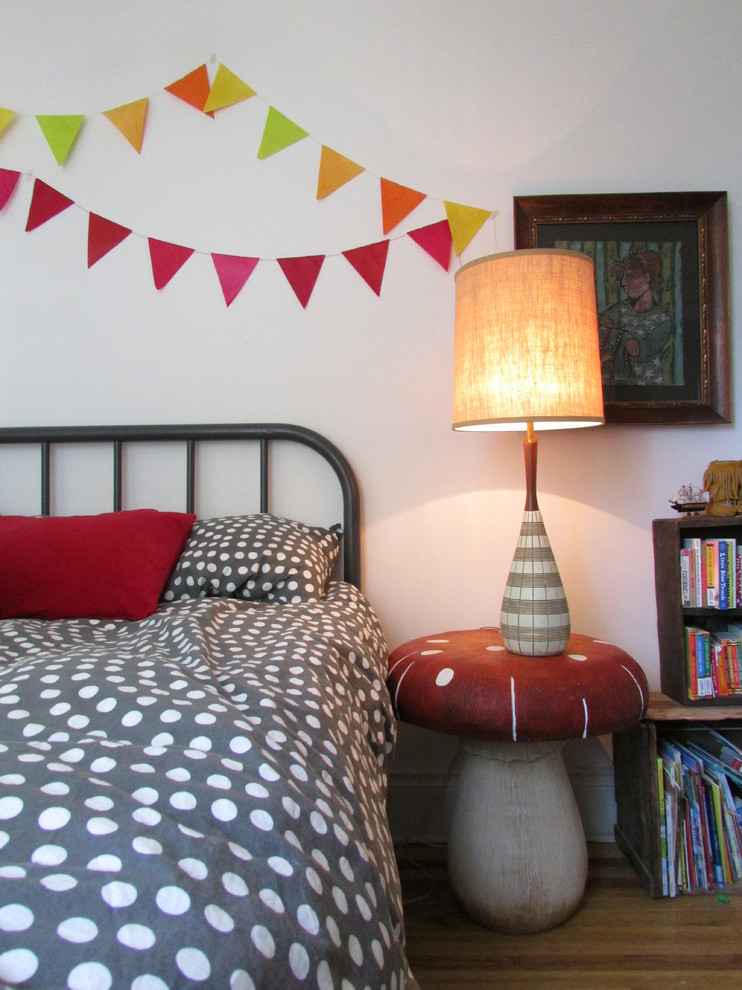 Eclectic gender-neutral medium tone wood floor kids' bedroom photo in Toronto with white walls