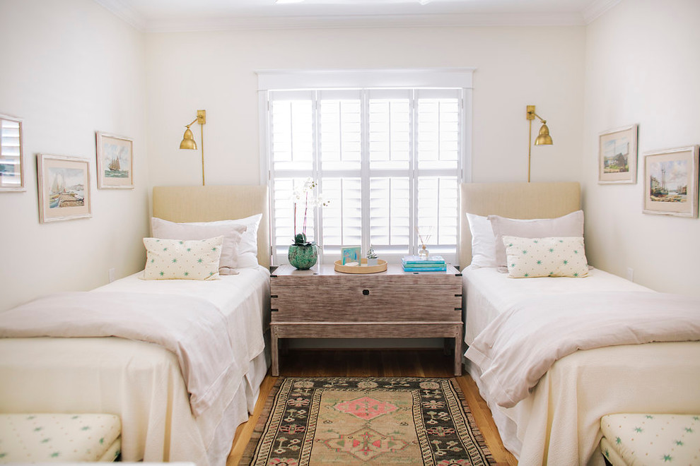 Design ideas for a medium sized beach style children's room for girls in Houston with white walls and light hardwood flooring.