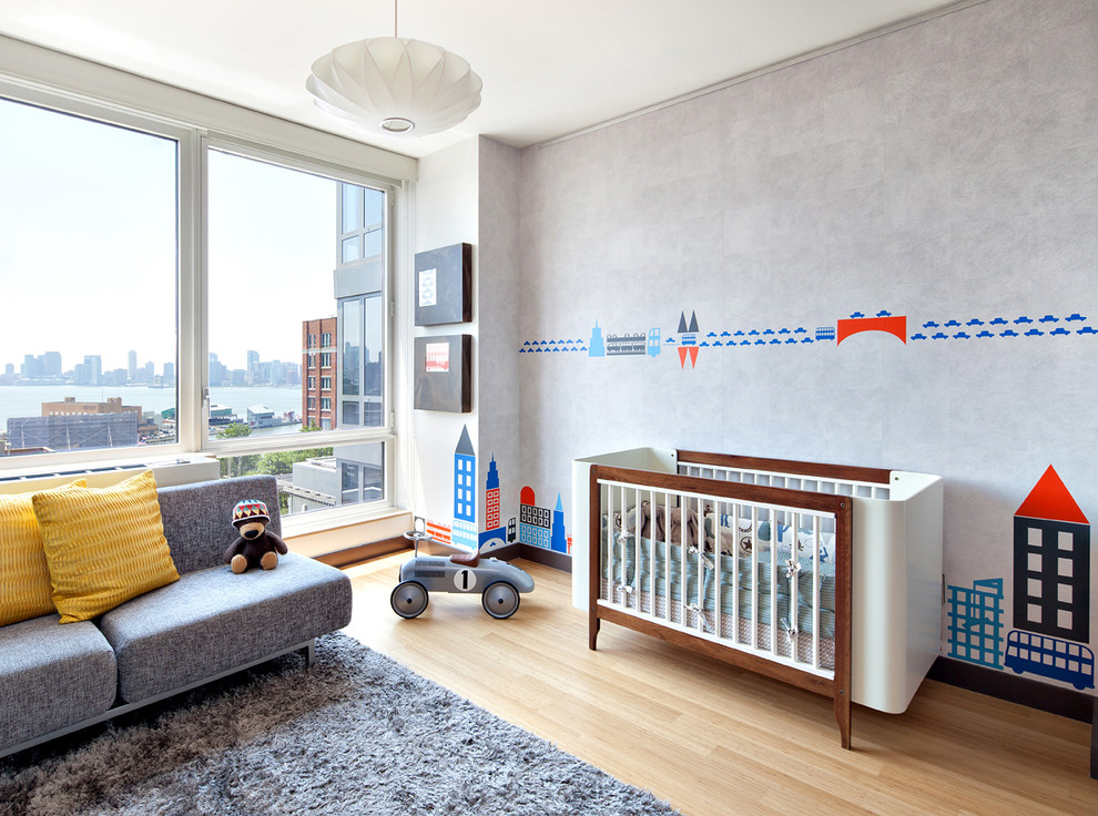 Example of a mid-sized trendy boy medium tone wood floor and beige floor kids' room design in New York with gray walls