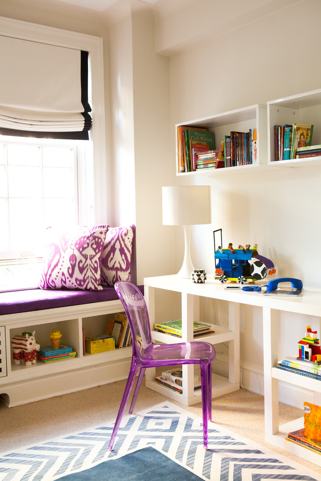 Example of a trendy girl carpeted kids' room design in New York with beige walls