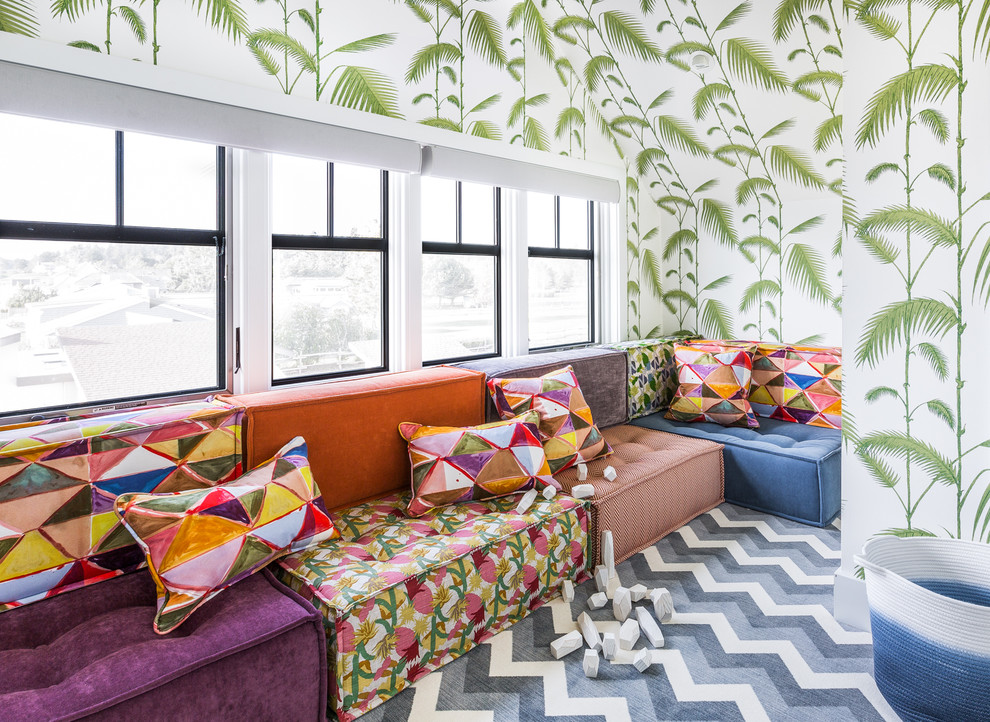 Example of a beach style gender-neutral carpeted and multicolored floor kids' room design in Seattle with multicolored walls