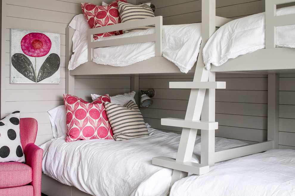 Kids' room - rustic girl kids' room idea in New York with gray walls