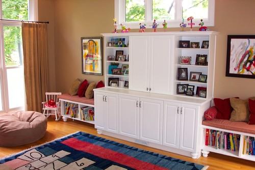 cuarto de juego con juguetes libros alfombra con juegos