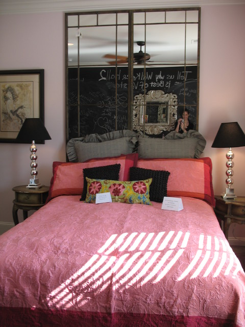 young lady's room with powder pink walls and a chalkboard wall for autographs kids