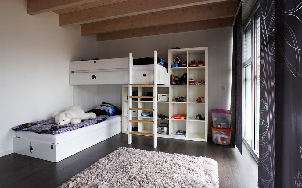 Inspiration for a huge contemporary boy dark wood floor and brown floor kids' room remodel in Other with white walls