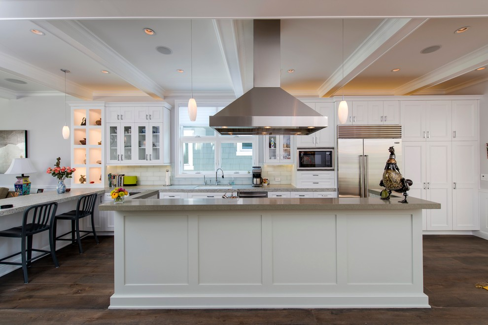Example of a classic galley open concept kitchen design in Los Angeles with shaker cabinets, white cabinets and stainless steel appliances
