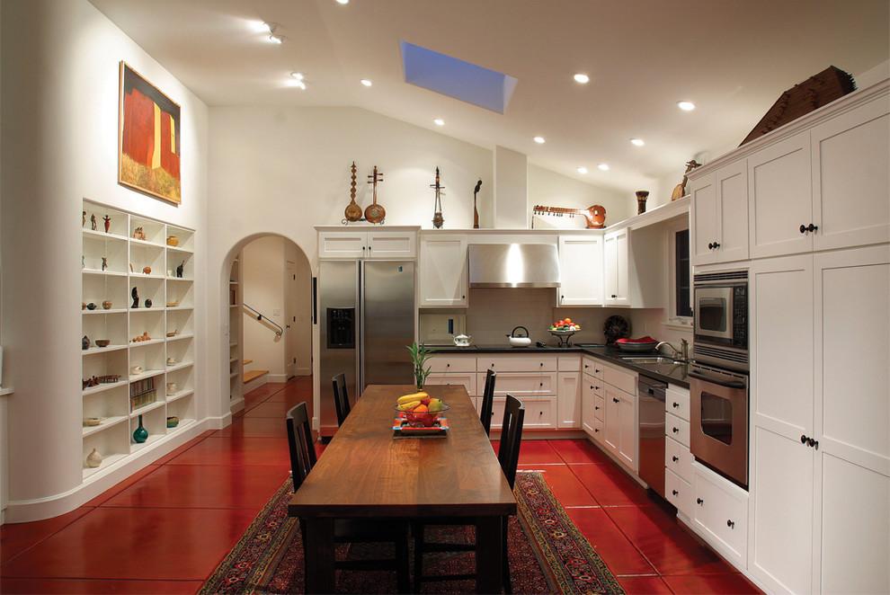 Kitchen - mediterranean l-shaped red floor kitchen idea in Los Angeles with shaker cabinets, white cabinets and stainless steel appliances