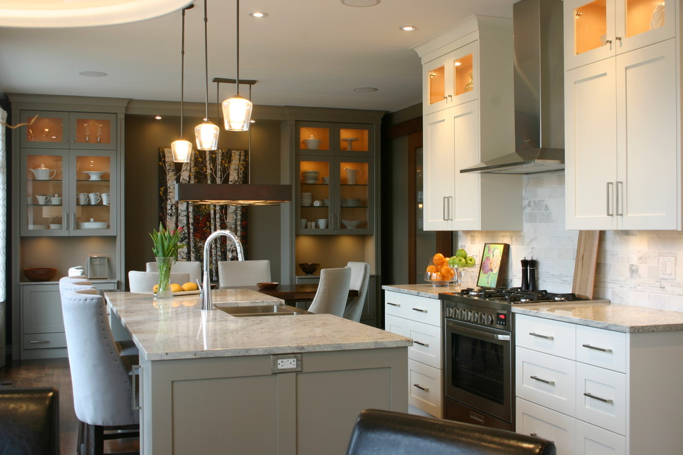 Inspiration for a contemporary galley eat-in kitchen remodel in London with white cabinets, white backsplash, stone tile backsplash and a double-bowl sink