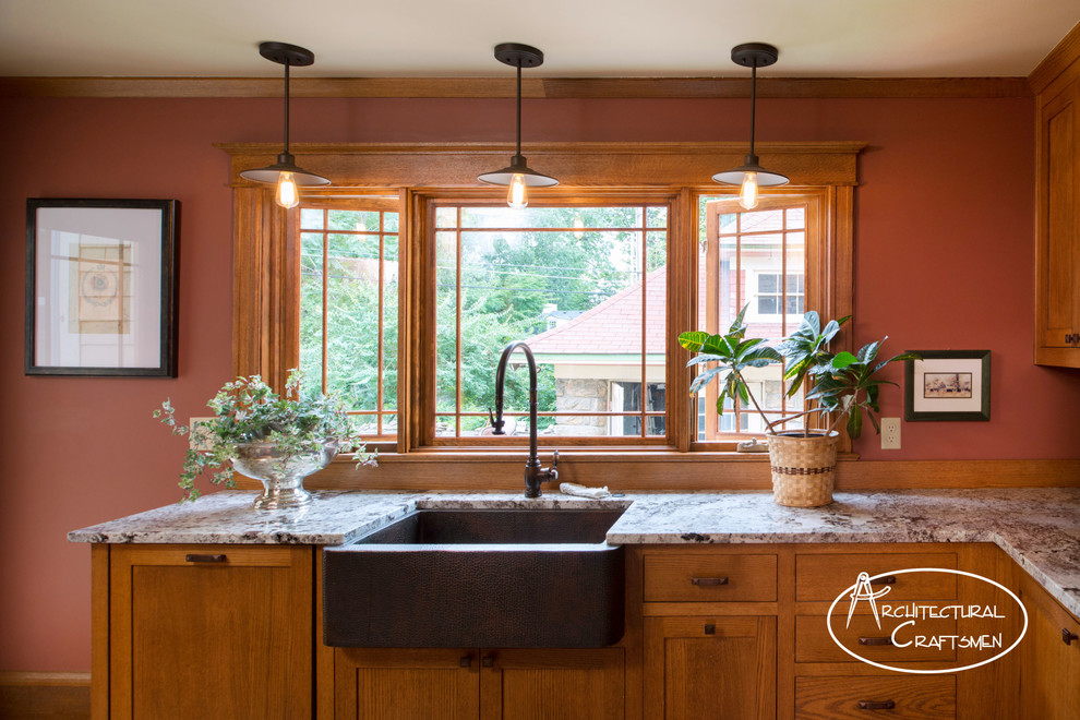 Mountain style kitchen photo in Kansas City with a farmhouse sink, shaker cabinets, medium tone wood cabinets, granite countertops and paneled appliances
