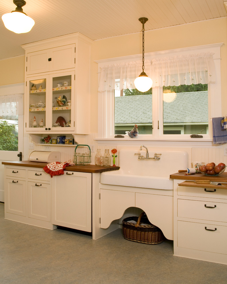 Kitchen - country kitchen idea in Seattle with a farmhouse sink and wood countertops