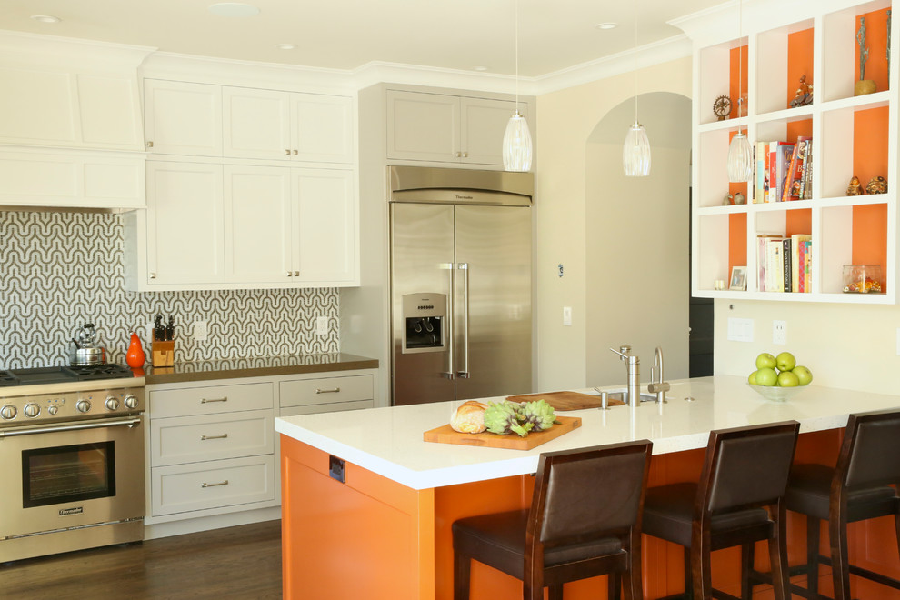 Trendy galley kitchen photo in San Francisco with recessed-panel cabinets, white cabinets and stainless steel appliances