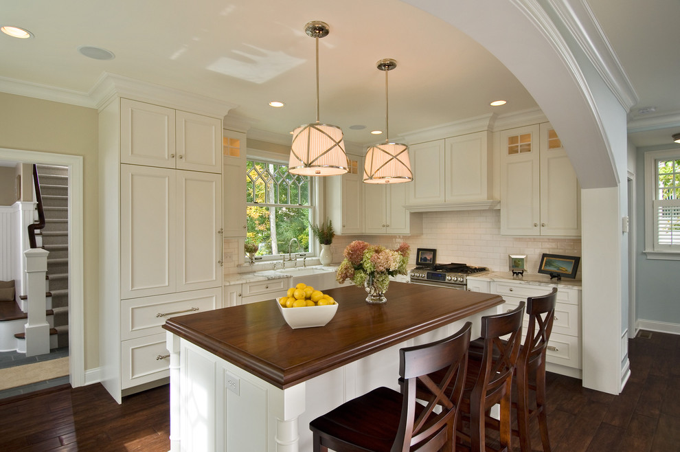 Inspiration for a timeless kitchen remodel in New York with subway tile backsplash and wood countertops