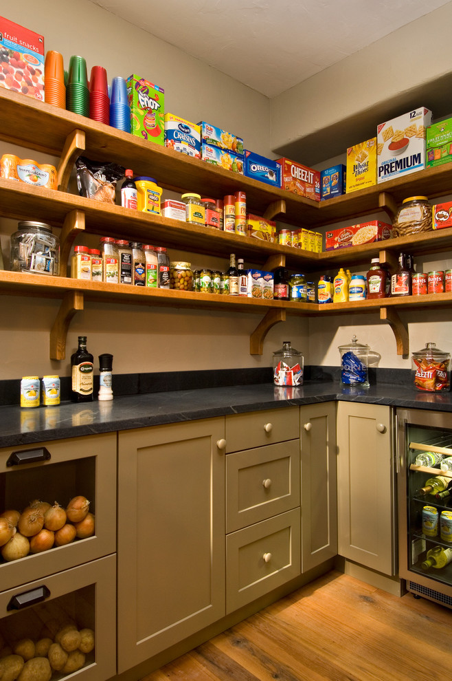 Kitchen pantry - rustic medium tone wood floor kitchen pantry idea in New York with open cabinets